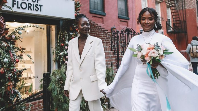 After their wedding in the town hall, model Aweng Ade-Chuol and Alexus Ade-Chuol commemorated the day with tattoos and pizza