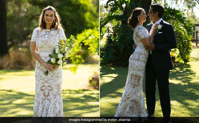 Evelyn Sharma is a stunning bride in a floral white lace wedding dress to marry Tushaan Bhindi in Australia